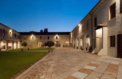 Night view of the ancient Portico della Meridiana (200 sits) Abbey of Santa Maria di Pero - Ninni Riva