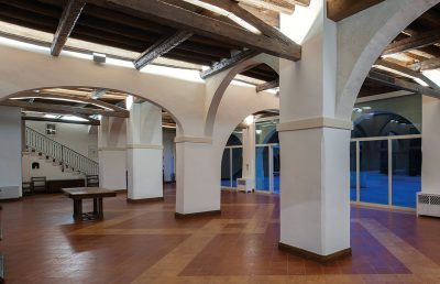 Salone del Consiglio with glassdoors on both sides overlooking the Cloister and the garden