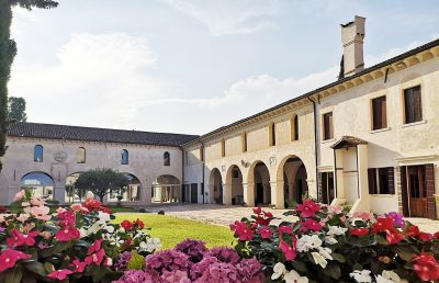 view cloister in bloom of the ninni abbey shore treviso